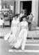 The ao dai (Vietnamese: áo dài) is a Vietnamese national costume, now most commonly for women. In its current form, it is a tight-fitting silk tunic worn over pantaloons. The word is pronounced ow-zye in the north and ow-yai in the south, and translates as 'long dress'.<br/><br/>  The name áo dài was originally applied to the dress worn at the court of the Nguyễn Lords at Huế in the 18th century. This outfit evolved into the áo ngũ thân, a five-paneled aristocratic gown worn in the 19th and early 20th centuries. Inspired by Paris fashions, Nguyễn Cát Tường and other artists associated with Hanoi University redesigned the ngũ thân as a modern dress in the 1920s and 1930s.